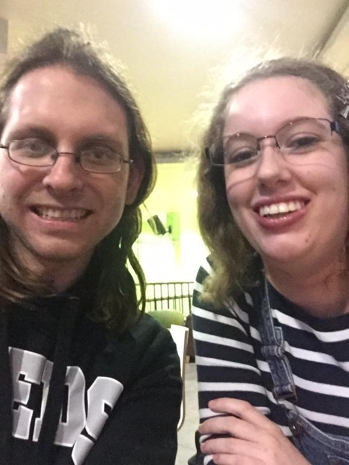 A selfie of myself & my husband as students. I'm wearing a navy blue & white striped jumper & blue dungarees, & Jarred is wearing a black University of Leeds hoodie.