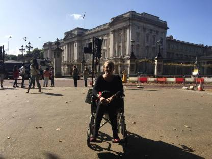 Sat in my manual wheelchair in front of Buckingham Palace.