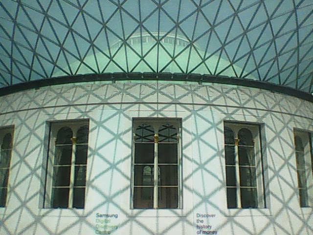 Looking up at the patterned roof in the central area of the British Museum.