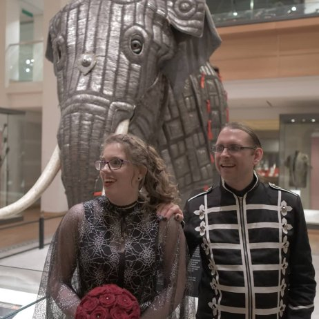 Jarred & I stood in front of the war elephant in the Royal Armouries. The hood of my veil is down, & I am holding my bouquet.