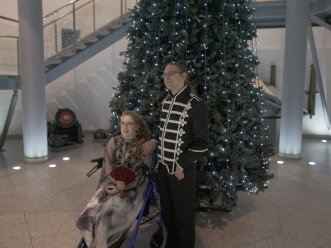 Jarred & I sat in front of the large Christmas tree in the museum foyer.