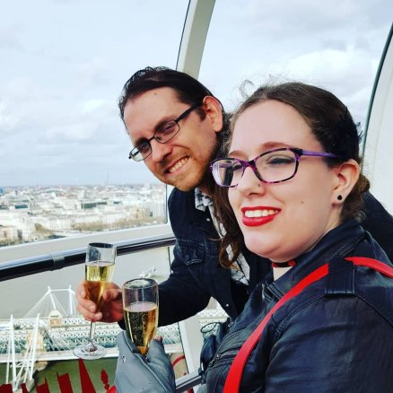My husband & I high above the London Skyline on the wheel, drinking champagne.