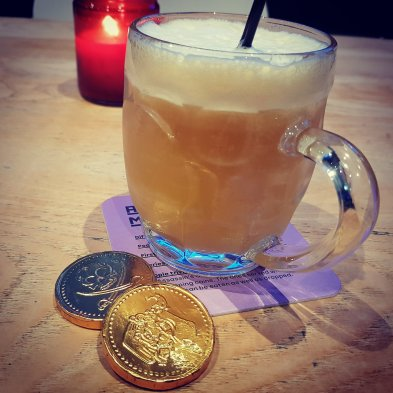 The Assassin's Mead, accompanied by 2 chocalte coins.