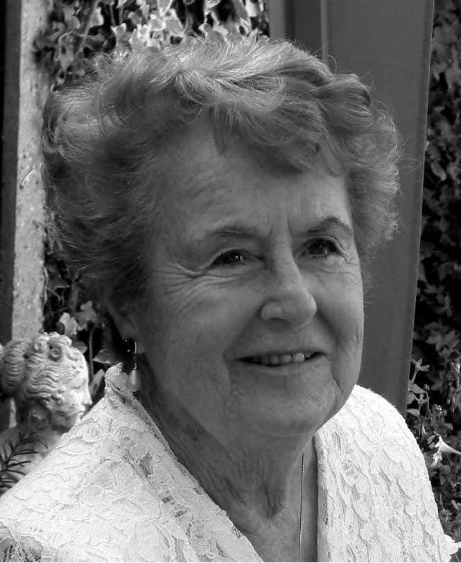 A black & white photograph of Sylvia from the shoulders up. She is in her 70s or 80s in picture.