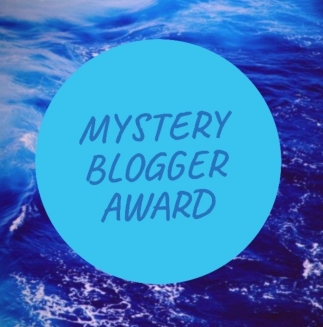 Mystery Blogger Award Logo. Mauve all-capitals text in the centre of a turquoise circle, with an ocean background.
