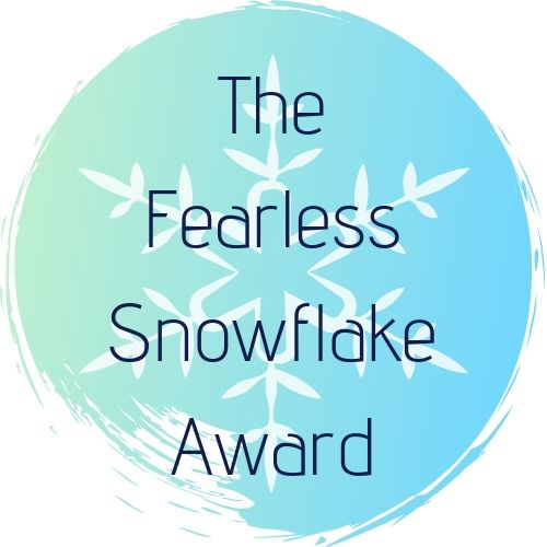 A teal circle on a white background, with a white snowflake in the centre. The Fearless Snowflake Award is written in deep blue text accross it.
