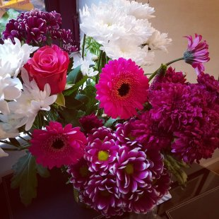 A large bouquet of pink, white & purple flowers, of many varieties.