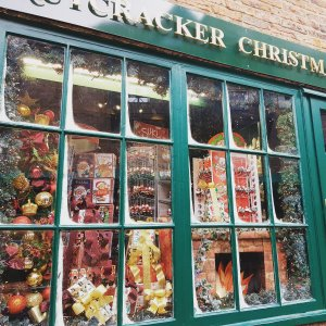 A traditional Christmas display in an old shop on the Shambles. The window frame is a deep green that compliments the bright colours behind it.