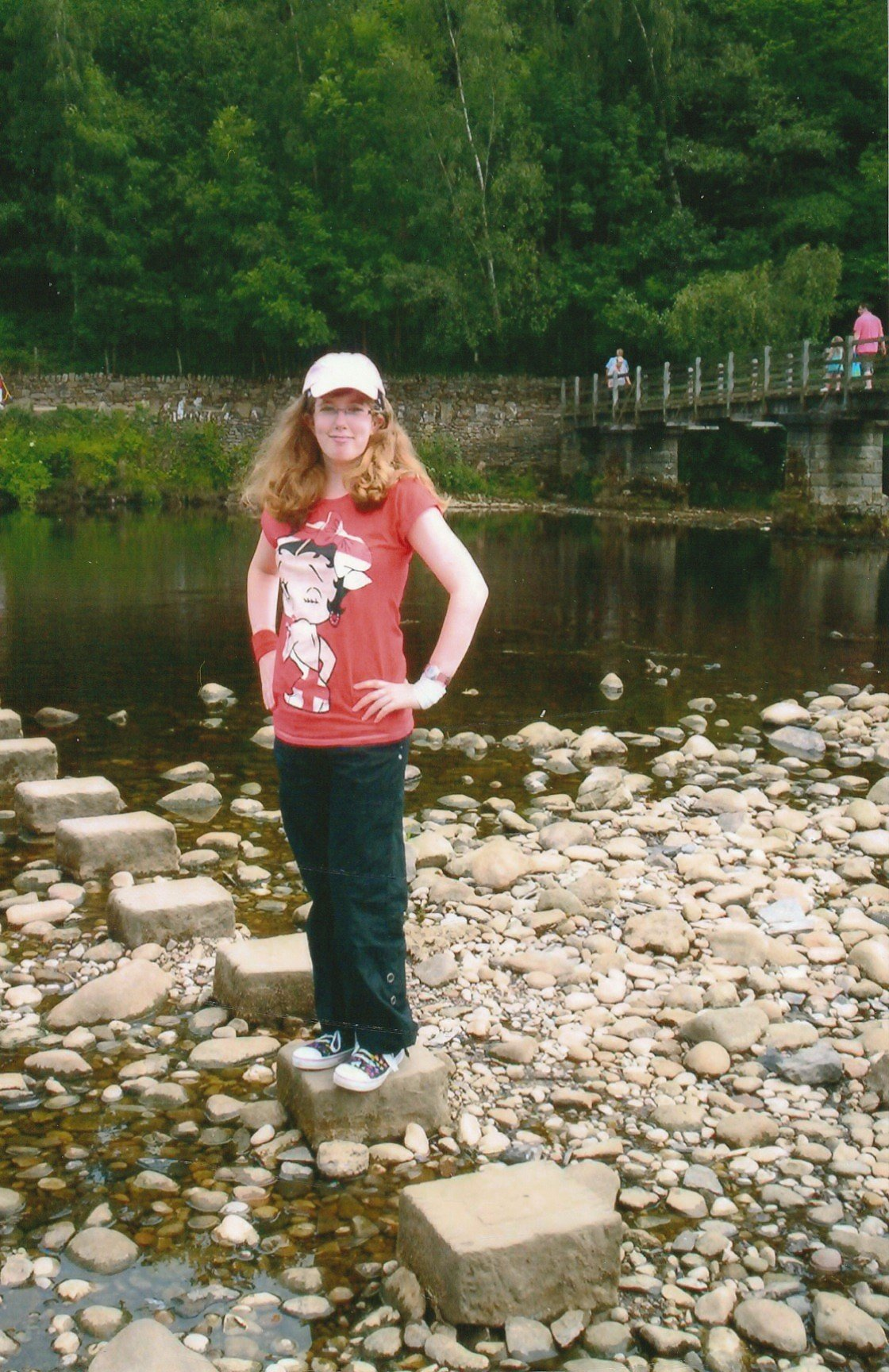 Stood on the first of the stepping stones to cross the river by Bolton Abbey. The 2010 world cup was on at the time, so I'm sporting a Betty Boop England t-shirt with my black cargo pants & converse. My blonde hair is loose & unruly as ever.