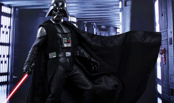 Darth Vader doing a dramatic cape sweep.