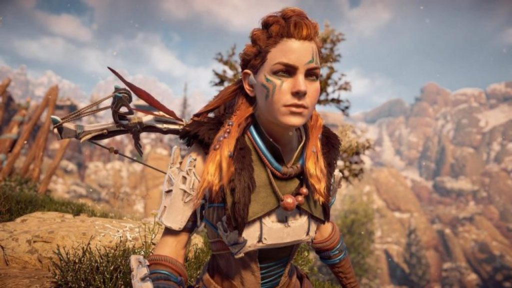 Flame-haired Aloy, with a bow on her back, wanders through what was once America.