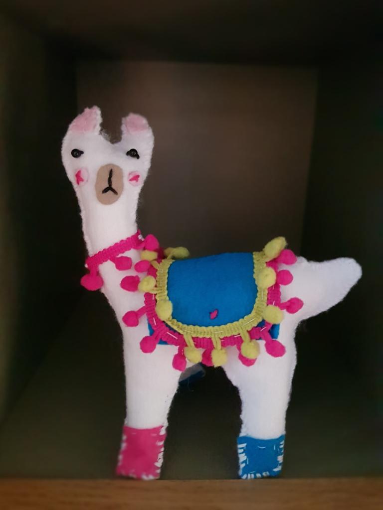 A white felt llama.