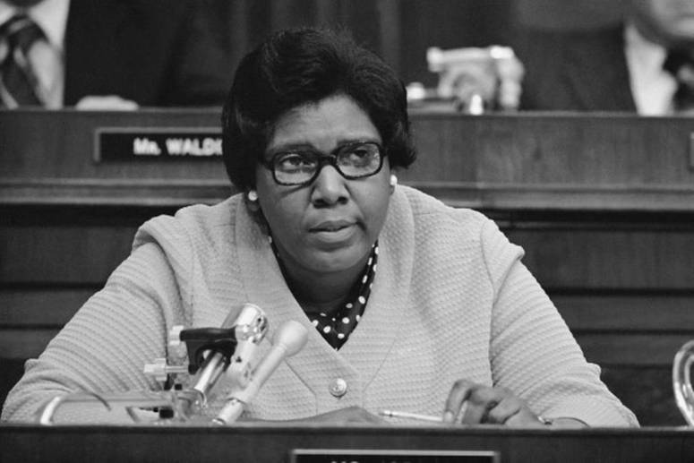 A black and white photograph of Barbara Jordan at work.